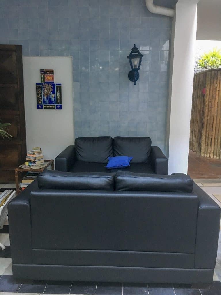 Two black leather sofas inside a pousada