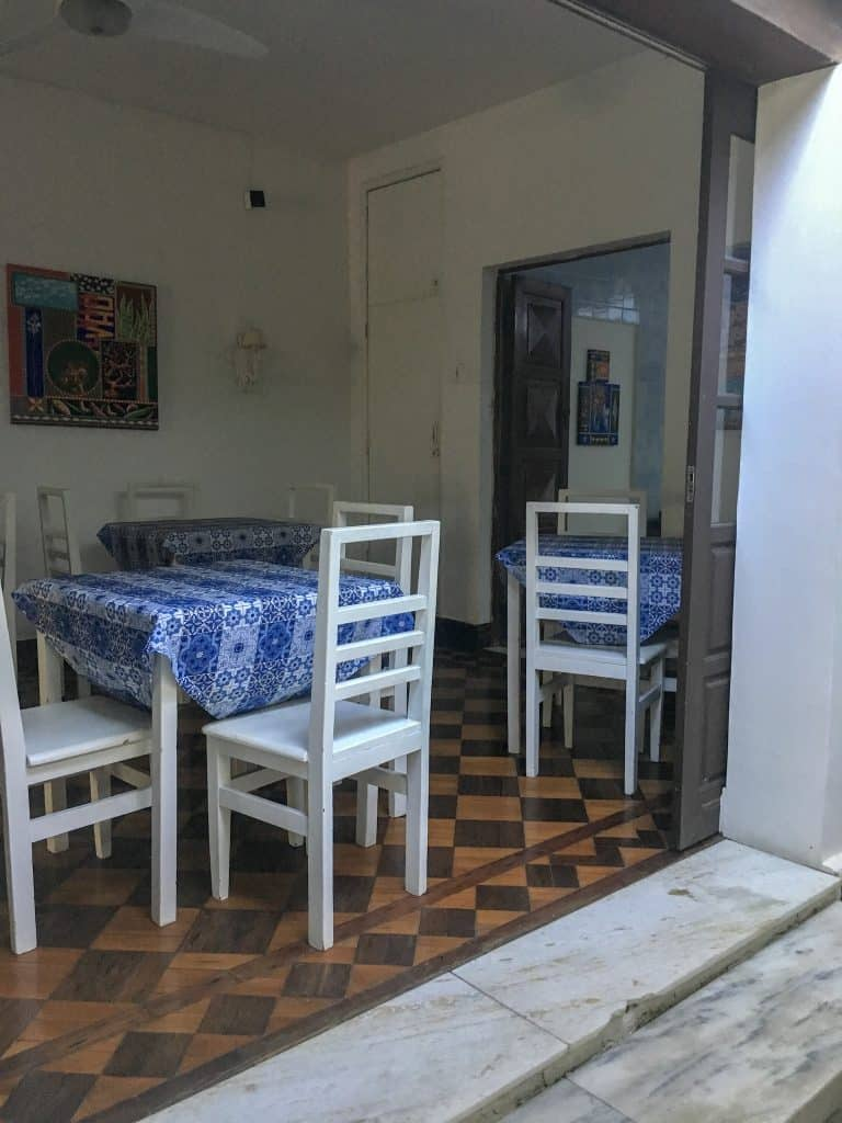 Tables and chairs in a breakfast area at a pousada
