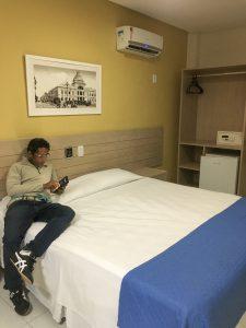 Hotel room — bed, mini-fridge, safe, air conditioning