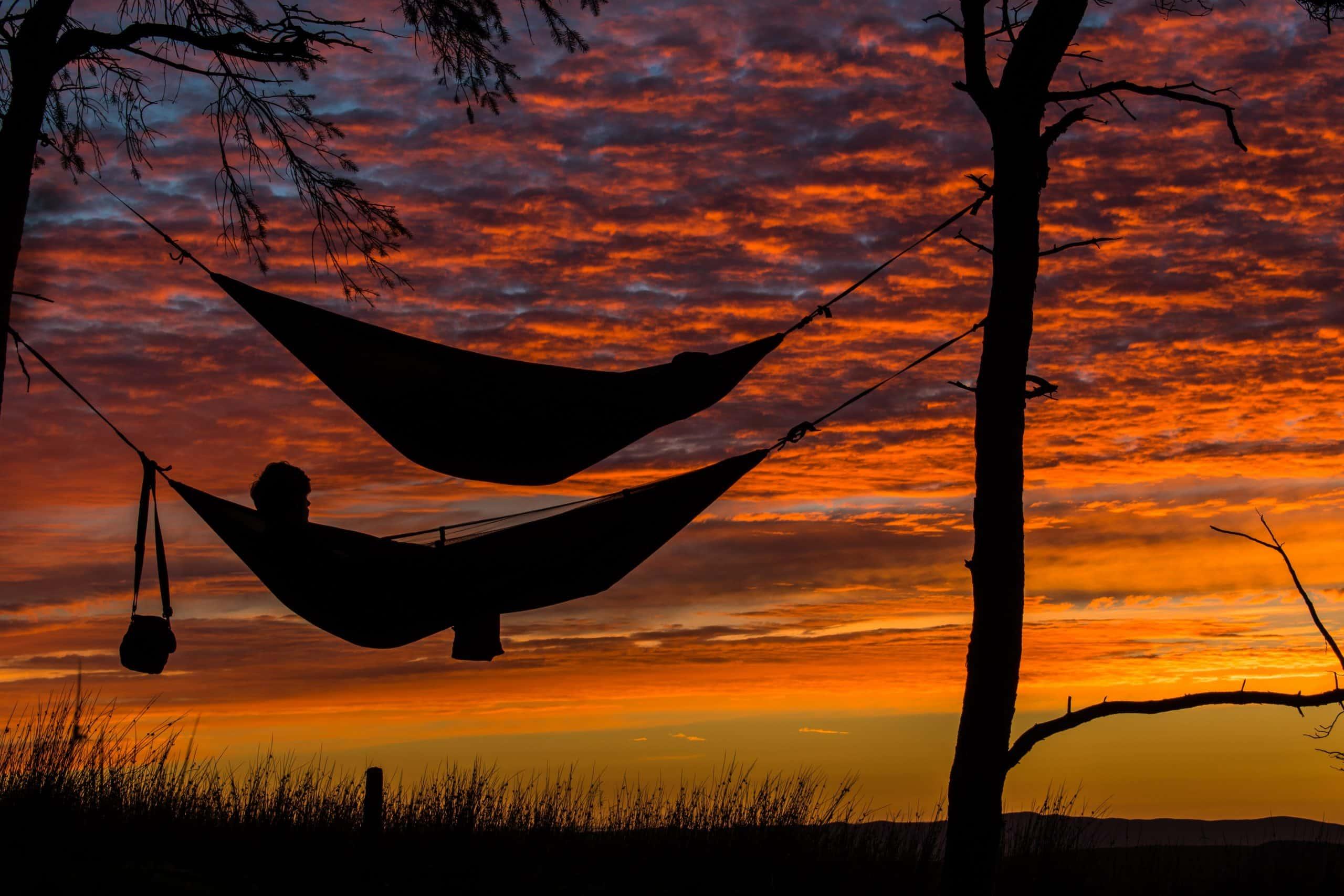 beach with hammocks at sunset