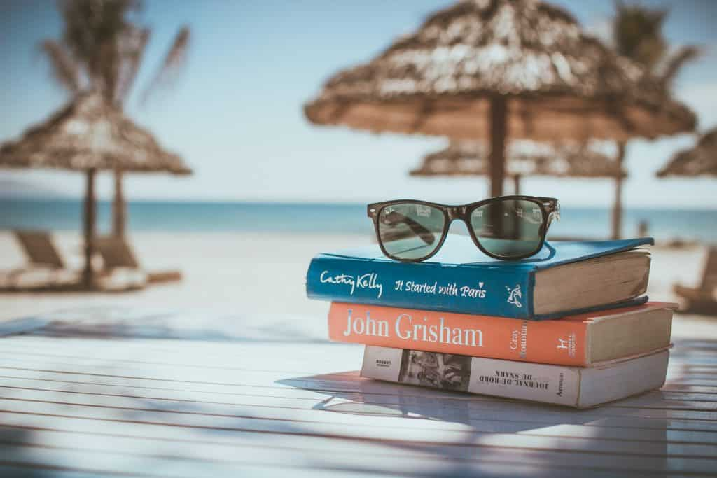 Books stacked on a table at the beach