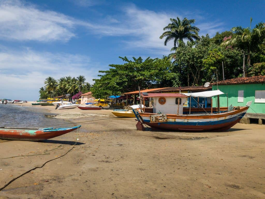 Wooden fishing boat docked on the sand