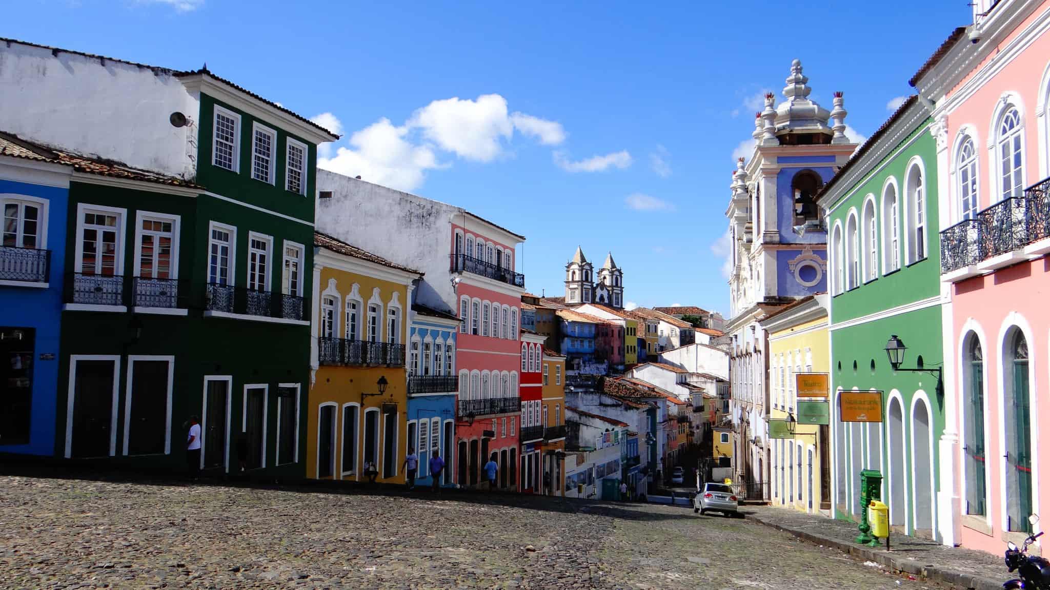 colorful old buildings surrounding a cobblestone square